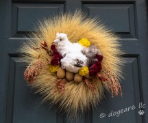 Dried grass, cotton, celosia (the flower), wooden eggs