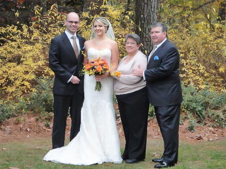 The bride and groom with her parents.