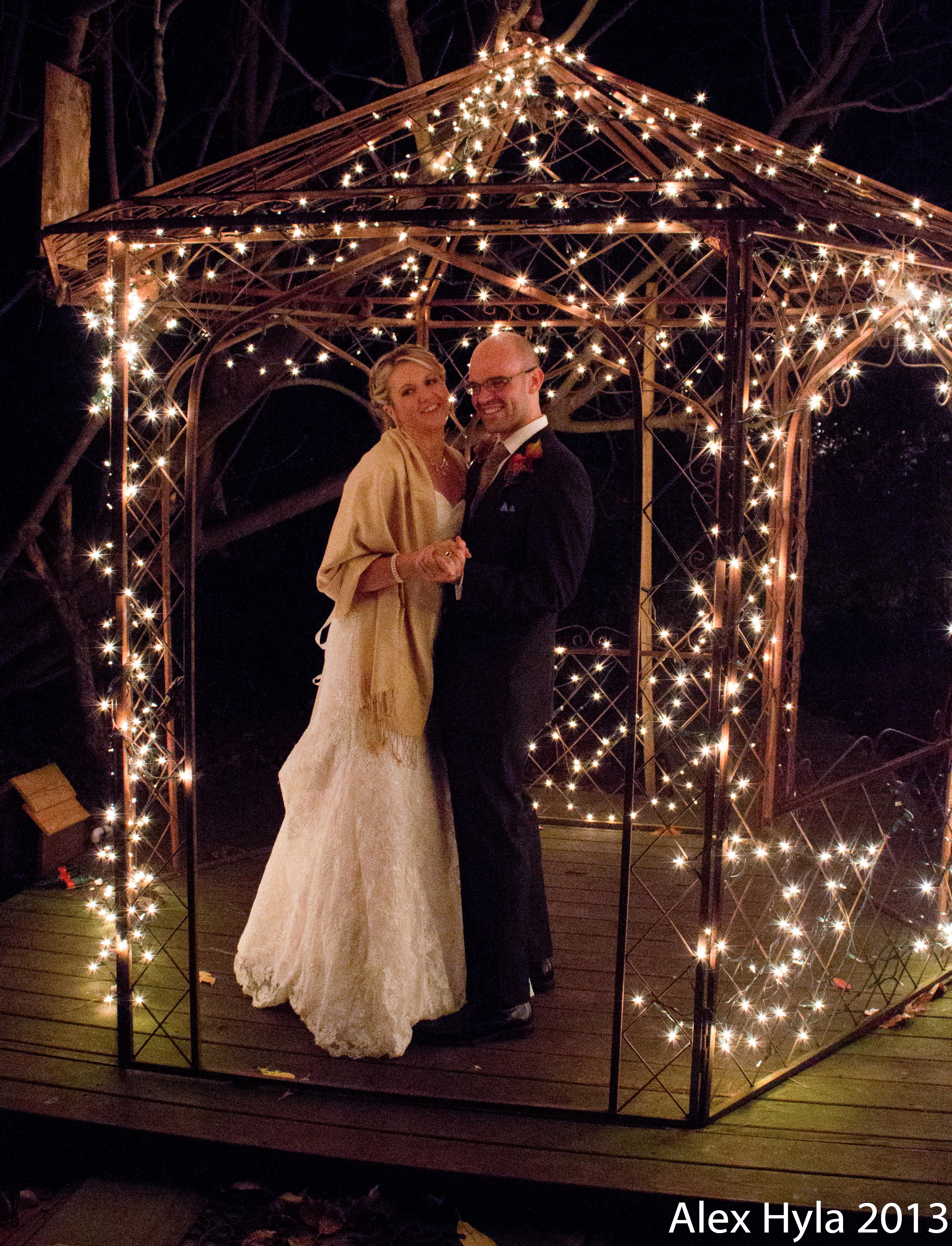 Something about the lights in the gazebo made her diamond ring glitter like a strobe light - it was really cool!