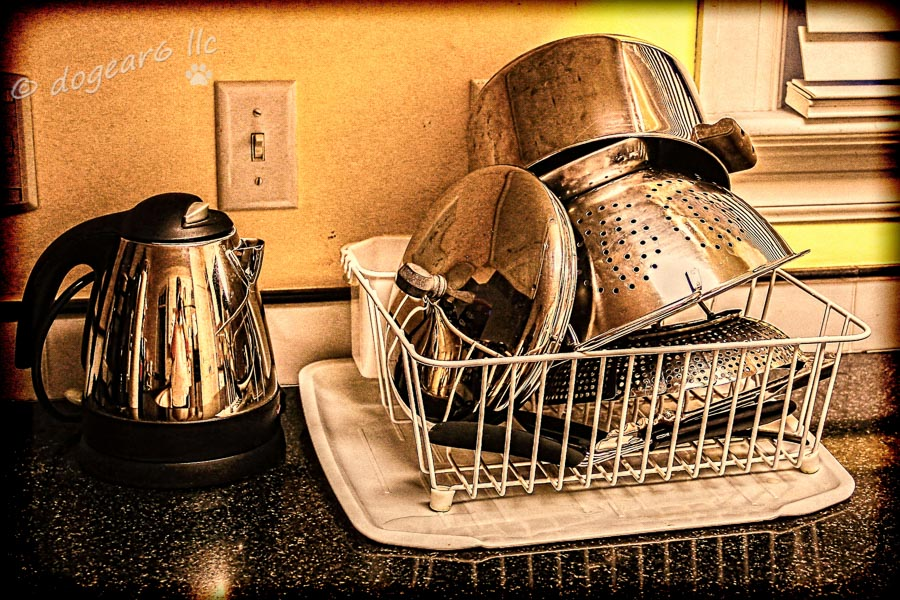A photo on an uninspired day of my daily photo challenge; edited with a vintage filter.  See the photographer in the teapot?