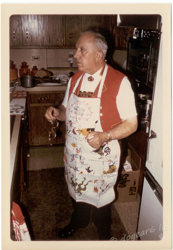 Grandpa getting ready to carve up the meat at Christmas