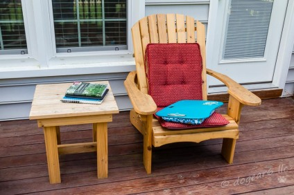 My chair and it's comfy pads along with a pile of books and my notebook.